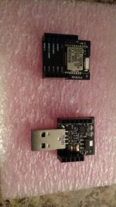 The top is the RFduino, the bottom is the USB shield, which is the easiest way to load it.
